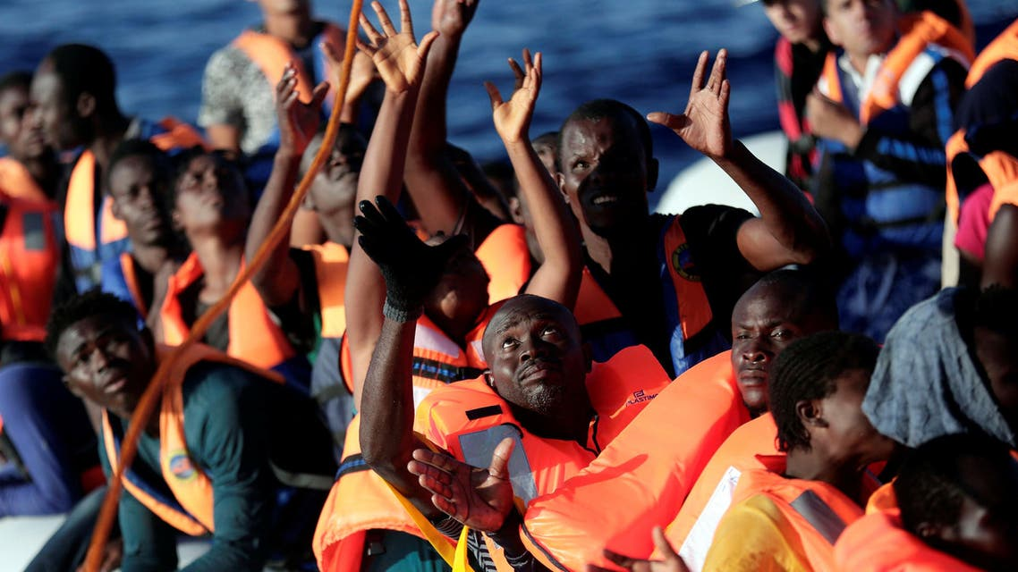 Migrants are seen before they embark on Migrant Offshore Aid Station (MOAS) rescue vessel Phoenix during a rescue operations in the international waters between Malta and Libya on August 10,2016. reuters