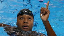 Manuel becomes first African American woman to win swim gold