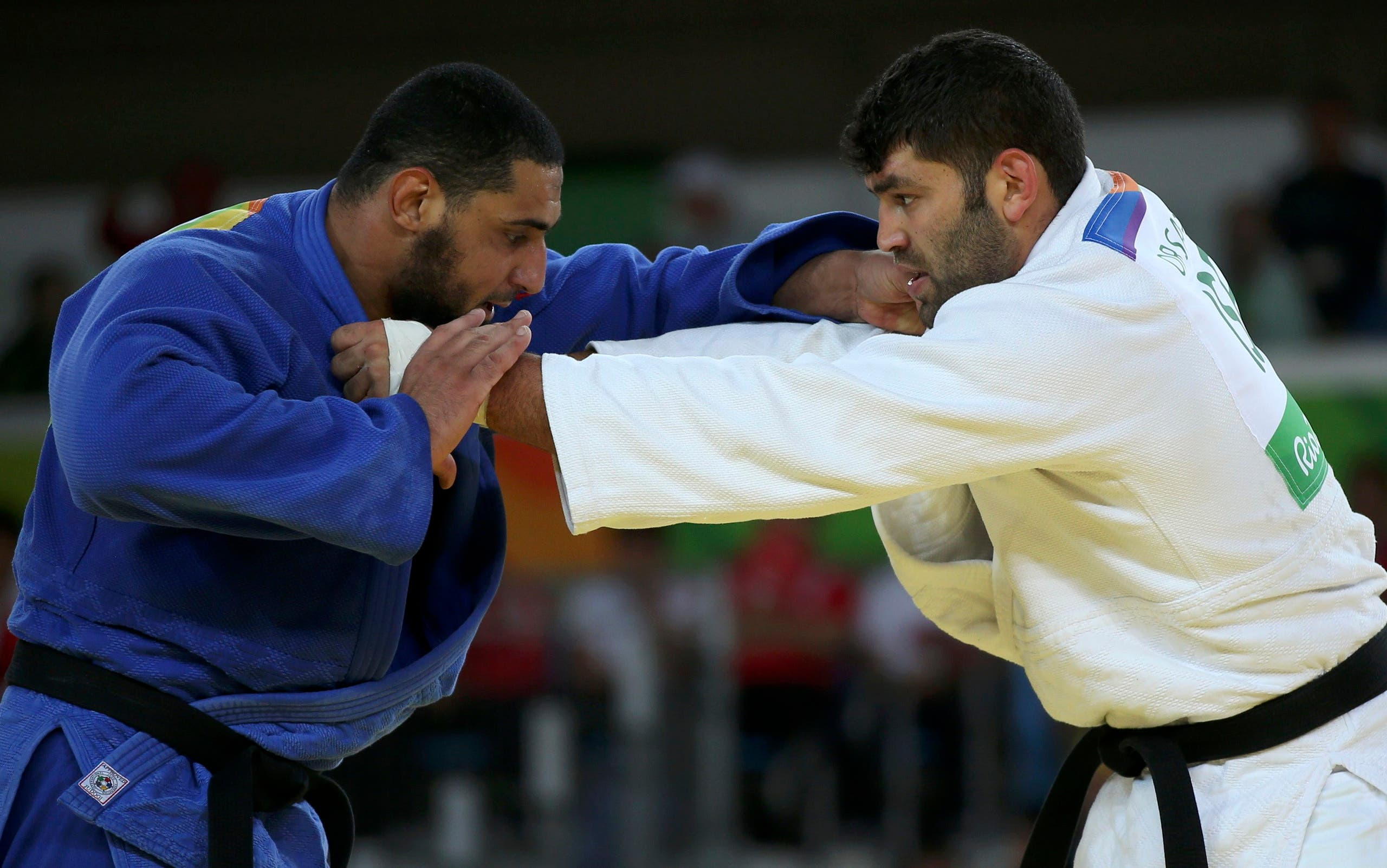 Or Sasson (ISR) of Israel and Islam El Shehaby (EGY) of Egypt compete. REUTERS