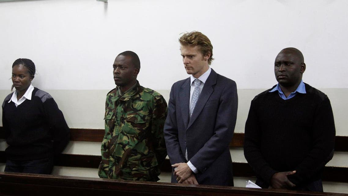"British national Jack Alexander Wolf Marrian (2nd R), flanked by police officers, appears in court in Nairobi on August 8, 2016, where he faces charges of trafficking 100 kilos of cocaine from Brazil to the port of Mombasa. A British sugar trader facing charges of trafficking cocaine worth $5.8 million was bailed on August 8, 2016 by a Nairobi court, with his lawyer declaring ""the wrong man"" was being targeted over a tampered shipment from Brazil. Jack Marrian, 31, from an aristocratic family has lived in east Africa since early childhood. He was charged on August 4, 2016 after police in the eastern port city of Mombasa seized 100 kilos (220 pounds) of cocaine hidden in a sugar consignment ordered by his firm. AFP"