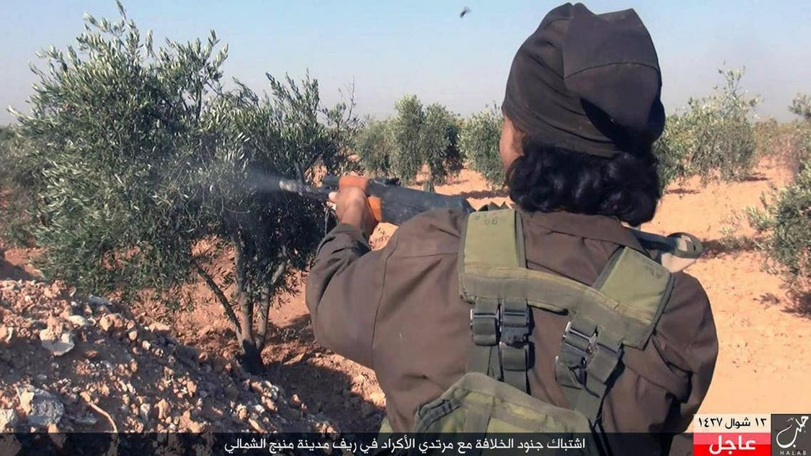 """This image posted online on Monday, July. 18, 2016, by supporters of the Islamic State militant group on an anonymous photo sharing website, shows an Islamic State fighter fires his weapon during clashes with the Kurdish-led Syria Democratic Forces in Manbij, in Aleppo province, Syria. The Arabic caption on the photo reads, """"Soldiers of the caliphate clash with Kurdish infidels in northern countryside of Manbij."""" (militant photo via AP)"""
