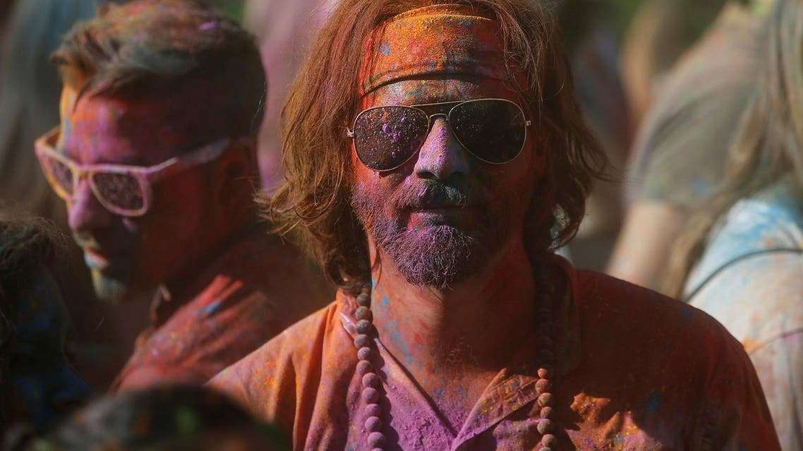 A reveler takes part take part in the Monsoon Holi Madrid festival in Madrid, Spain, August 13, 2016. (Photo: REUTERS/Javier Barbancho)