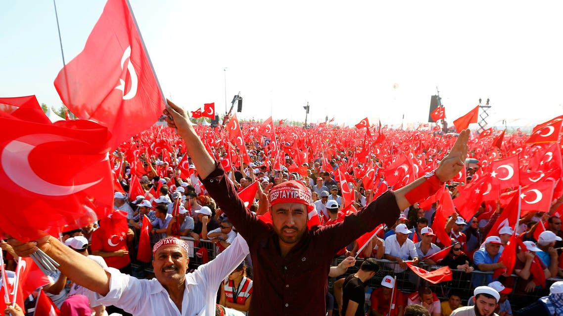 People wave Turkey's national flags during the Democracy and Martyrs Rally, organized by Turkish President Tayyip Erdogan and supported by ruling AK Party (AKP), oppositions Republican People's Party (CHP) and Nationalist Movement Party (MHP), to protest against last month's failed military coup attempt, in Istanbul, Turkey, August 7, 2016. REUTERS