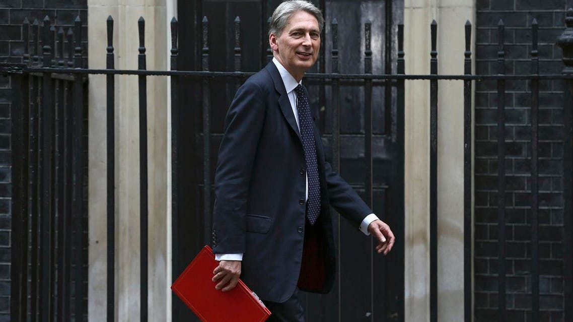 """Britain's Chancellor of the Exchequer Philip Hammond arrives for a meeting of the """"Cabinet Committee on Economy and Industrial Strategy"""" at Number 10 Downing Street in London, Britain August 2, 2016. REUTERS/Neil Hall/File Photo"""