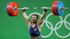 Iran breaks world record, wins gold in Olympics weightlifting