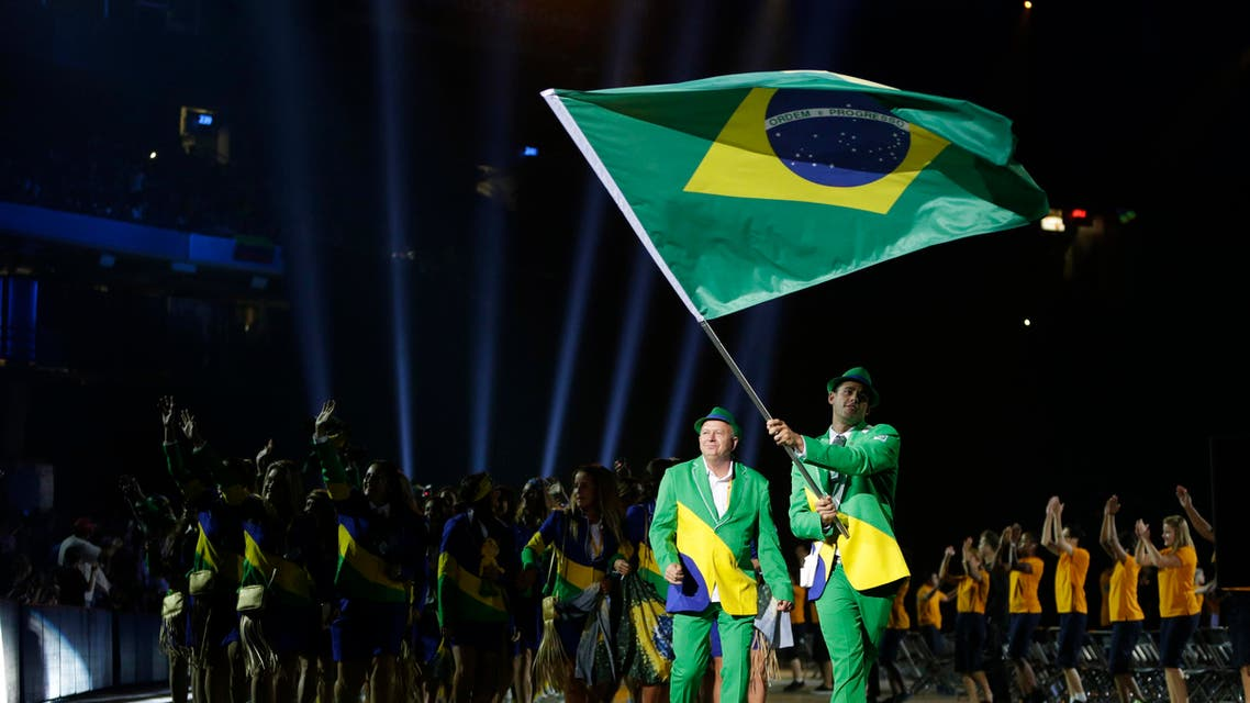 Brazil's Thiago Pereira carries his nation's flag during the opening ceremony of the 2015 Pan Am Games in Toronto, Friday, July 10, 2015. (File Photo:AP)
