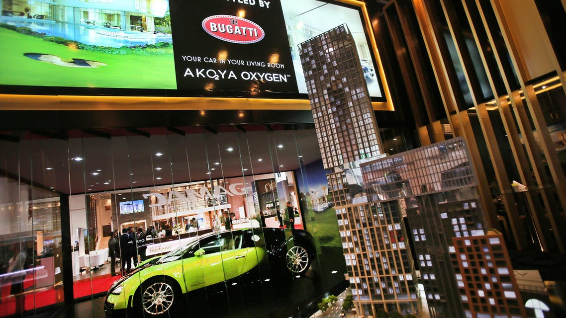 A Bugatti car is seen by the Damac Properties stand launching the world's first Bugatti-branded homes at Cityscape Global exhibition, Tuesday, Sept. 8, 2015, in Dubai