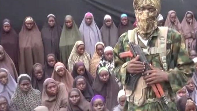Boko haram seen with the kidnapped chibok girls. (File Photo:Reuters)