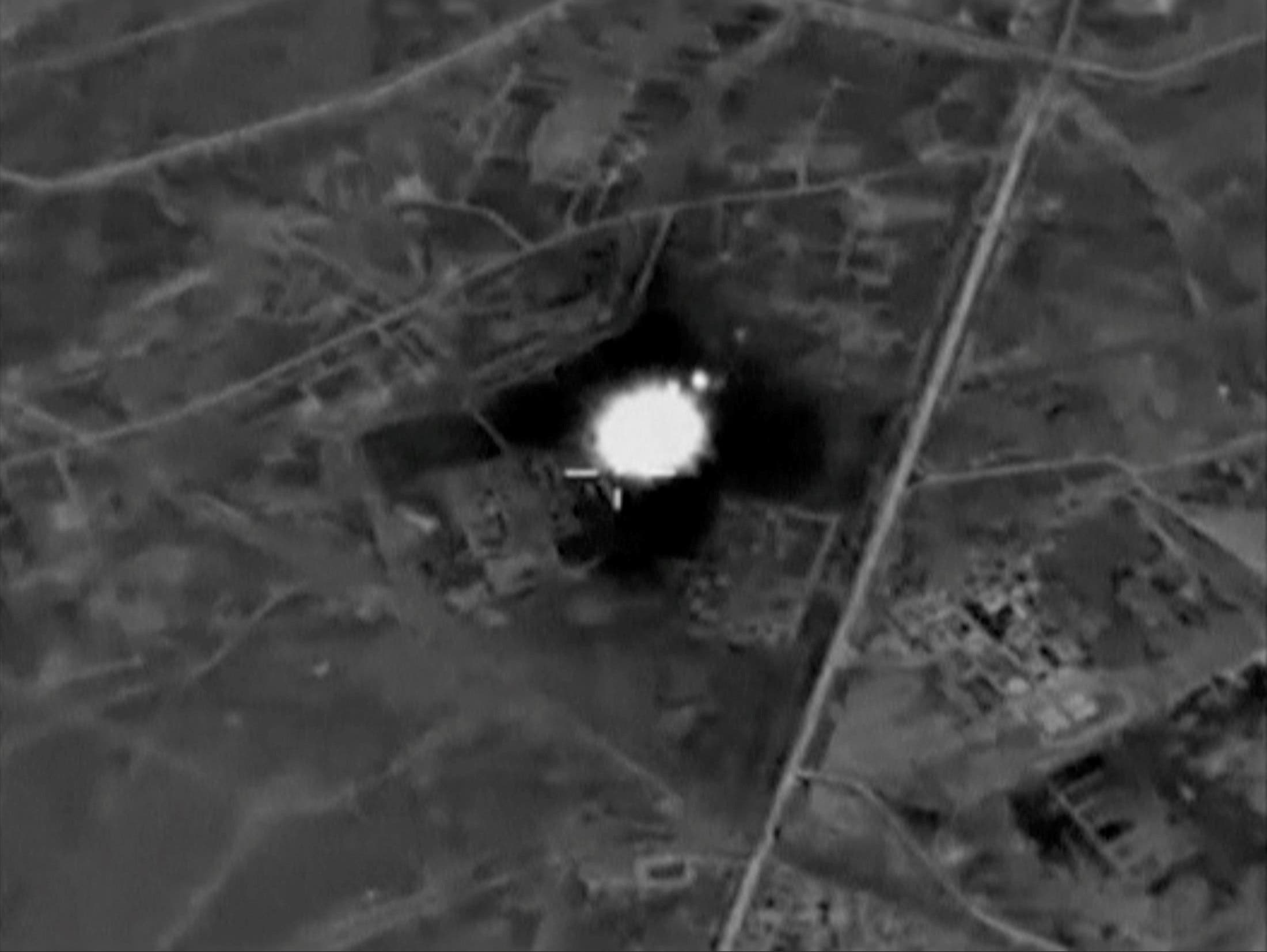 A still image, taken from video footage and released by Russia's Defence Ministry on August 11, 2016, shows airstrikes carried out by Russian Tupolev Tu-22M3 long-range strategic bombers and hitting infrastructure controlled by the Islamic State militants according to the ministry, at an unknown location in Syria. (Reuters)