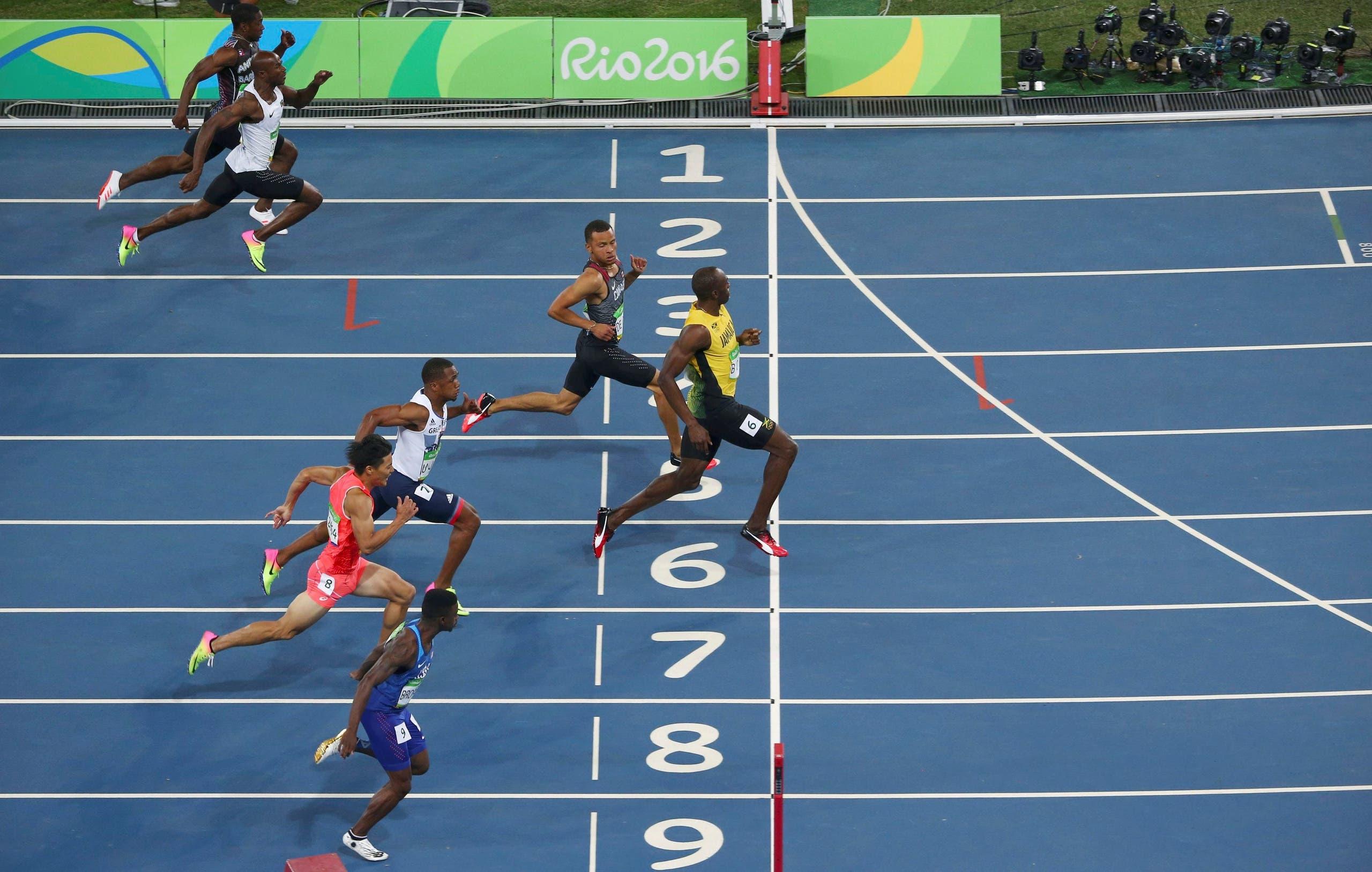 Usain Bolt (JAM) of Jamaica crosses the finish line. REUTERS