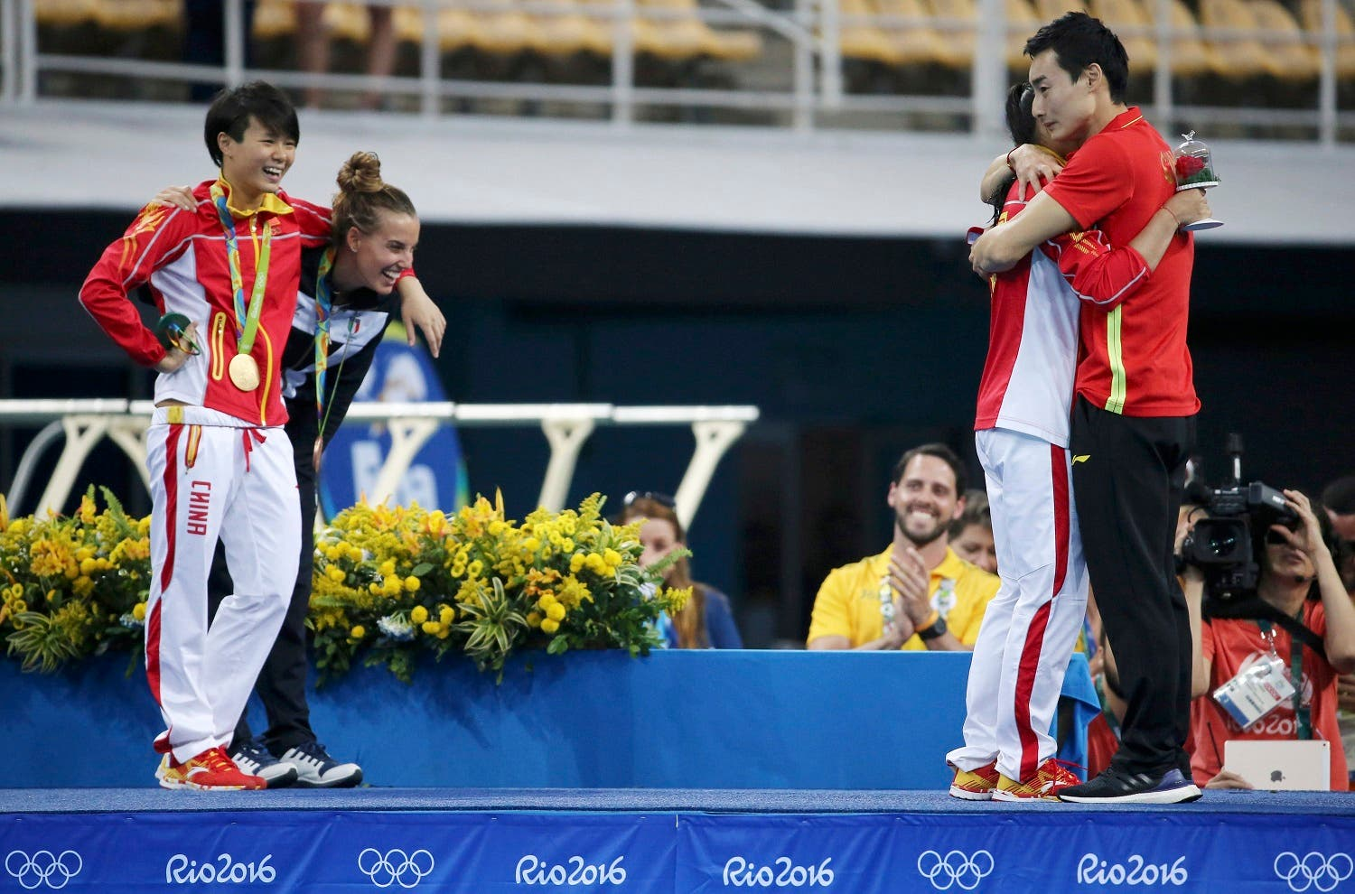 He Zi (CHN) of China recieves a marriage proposal from Olympic diver Qin Kai (CHN) of China after the medal ceremony. She accepted Qin's proposal. REUTERS