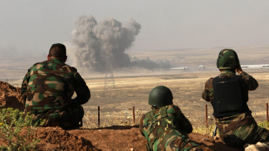 Smoke billows on the front line as Iraqi Kurdish Peshmerga fighters hold a position near Hasan Sham village, some 45 kilometres east of the city of Mosul, during an operation aimed at retaking areas from the Islamic State group on May 29, 2016. AFP