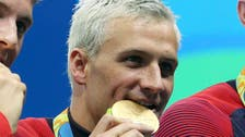 US swimmer Lochte says gun held to forehead in taxi hold-up