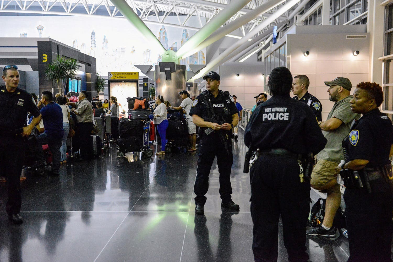 Members of the Port Authority Police Department stand guard at Terminal 8 at John F. Kennedy airport in the Queens borough of New York City. (Reuters)
