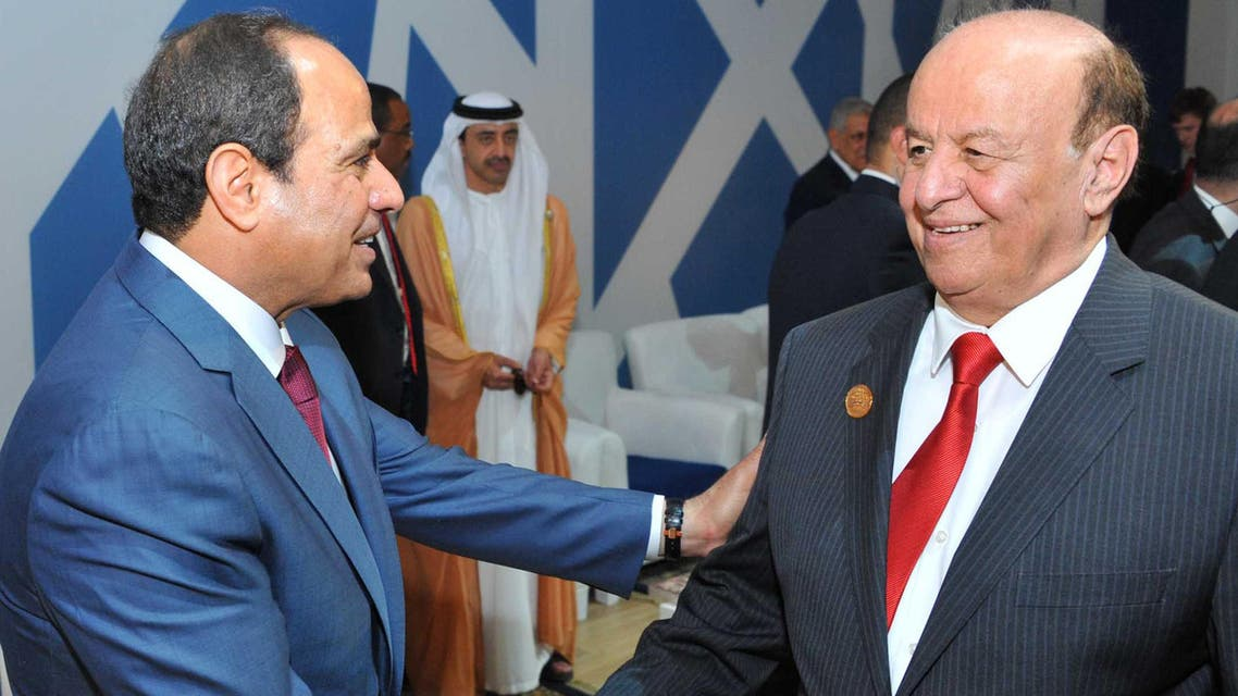 In this picture provided by the office of the Egyptian Presidency, Egyptian President Abdel-Fattah el-Sissi, left, talks to Yemen's exiled President Abed Rabbo Mansour Hadi following a ceremony unveiling a major extension of the Suez Canal in Ismailia, Egypt, Thursday, Aug. 6, 2015. (AP)