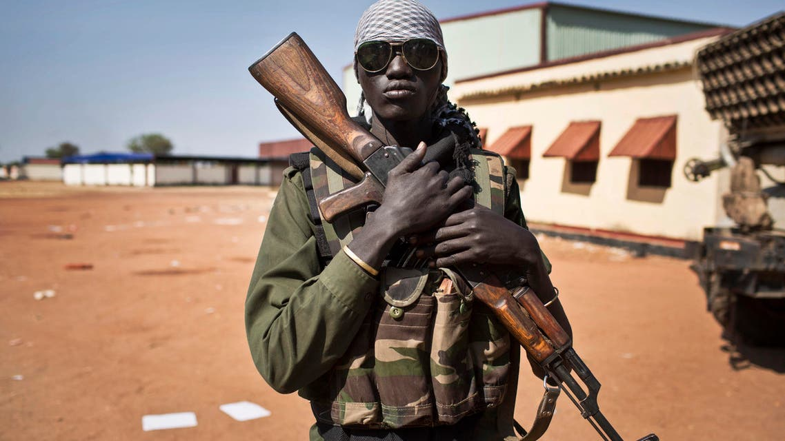 soldier stands outside headquarters in sudan. (AP)