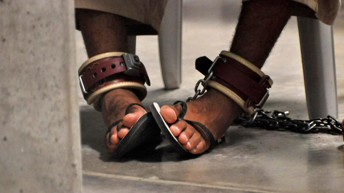 In this photo, reviewed by a U.S. Department of Defense official, a Guantanamo detainee's feet are shackled to the floor as he attends a 'Life Skills' class inside the Camp 6 high-security detention facility at Guantanamo Bay U.S. Naval Base April 27, 2010. (Reuters)