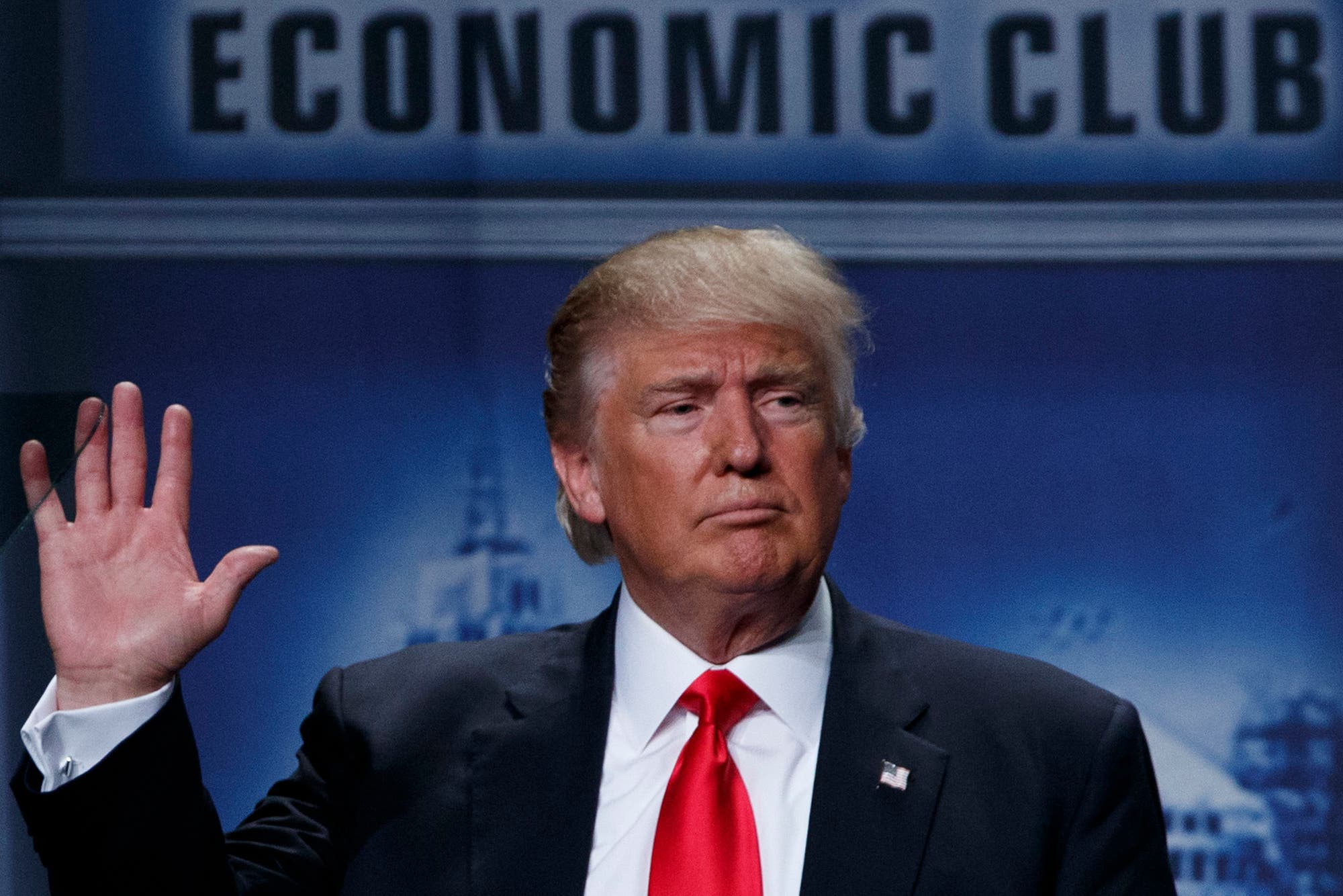 epublican presidential candidate Donald Trump waves after delivering an economic policy speech to the Detroit Economic Club, Monday, Aug. 8, 2016, in Detroit. (AP)