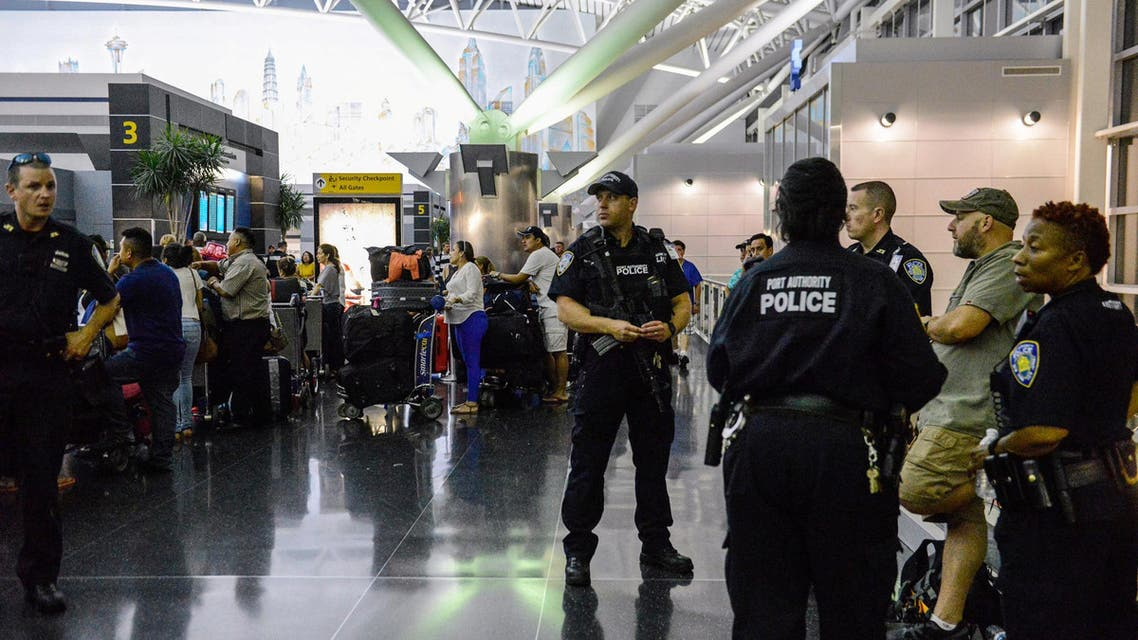 Members of the Port Authority Police Department stand guard at Terminal 8 at John F. Kennedy airport in the Queens borough of New York City, early August 15, 2016. REUTERS