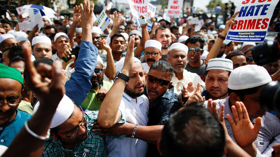 A crowd of community members shout slogans to stop crime after the funeral service of Imam Maulama Akonjee, and Thara Uddin in the Queens borough of New York City, August 15, 2016. REUTERS