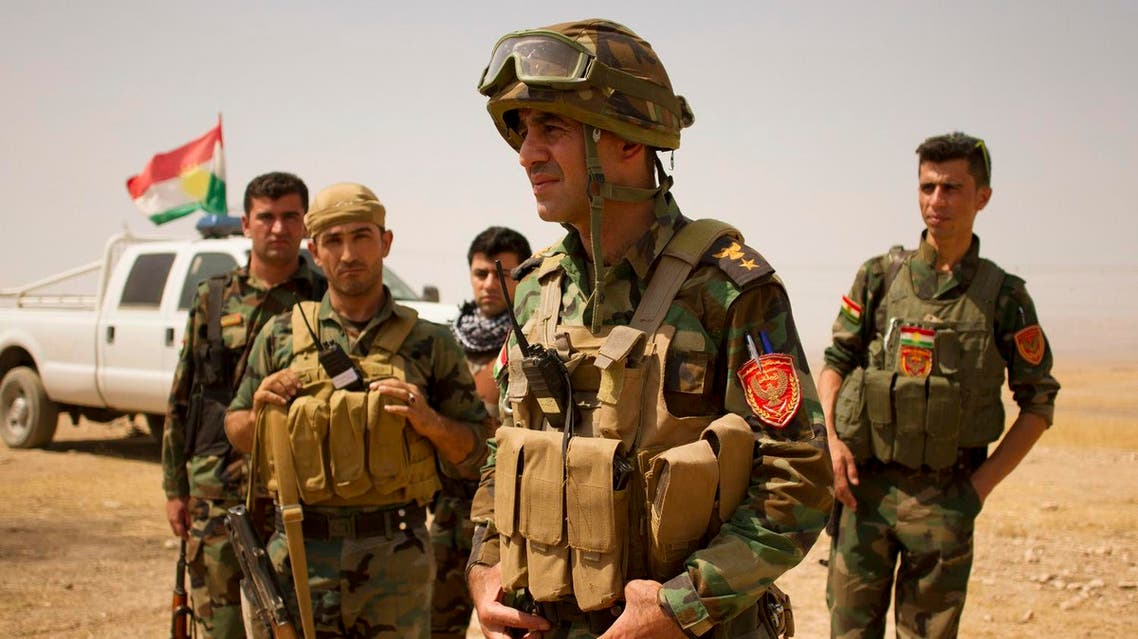Lt. Col. Arshad Hussein with the 1st Zerevani Brigade at a small outpost outside the village of Qarqashah, Iraq. (AP)