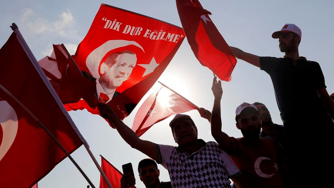 People wave Turkey's national flags during the Democracy and Martyrs Rally in Istanbul. (Reuters)