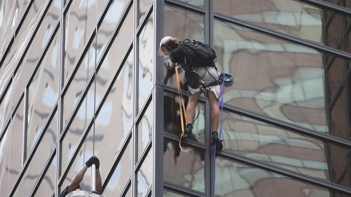 Stephen Rogata, 19, from Great Falls in Virginia, was captured and dragged through a window on the 21st floor of the 68-story skyscraper around three hours after he embarked on his dare-devil stunt