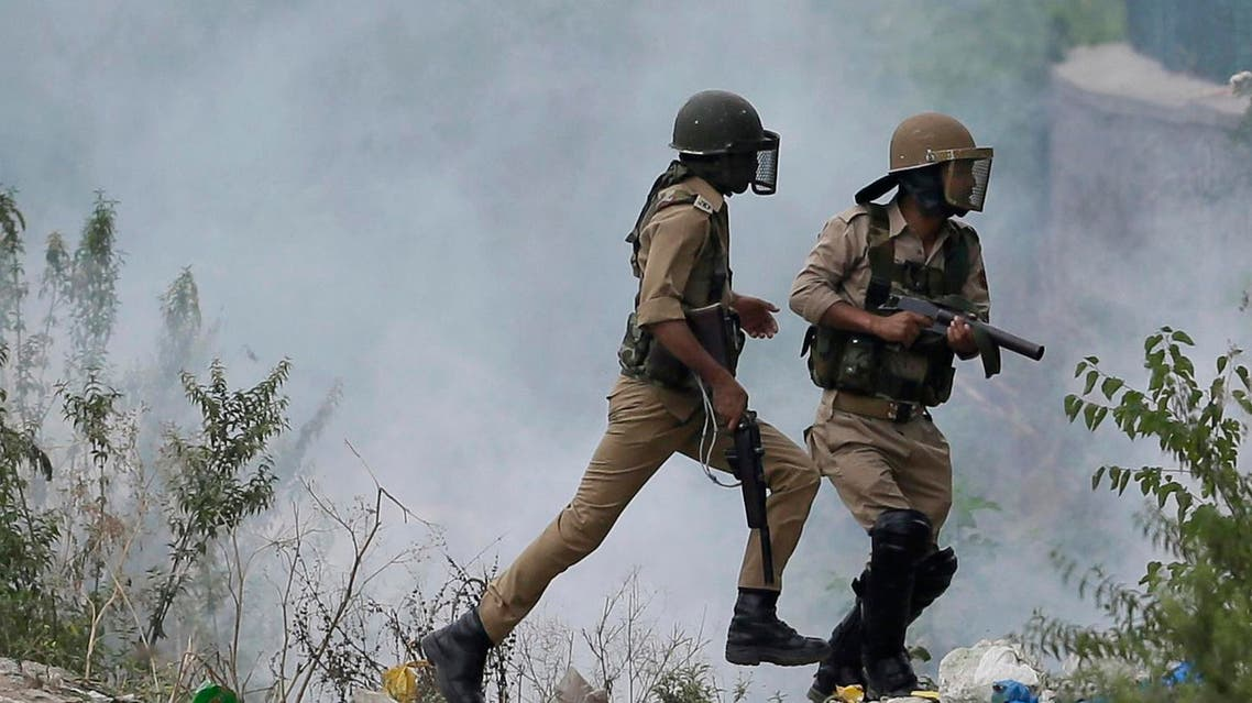 Indian policemen chase Kashmiri Muslim protesters in Srinagar, Indian-controlled Kashmir AP