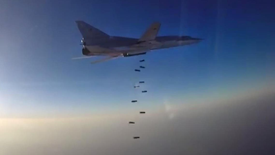 This video grab image created on August 16, 2016, taken from a footage released by the Russian Defence Ministry's official website, reportedly shows a Russian bomber Tupolev Tu-22M3 conducting airstrike. afp