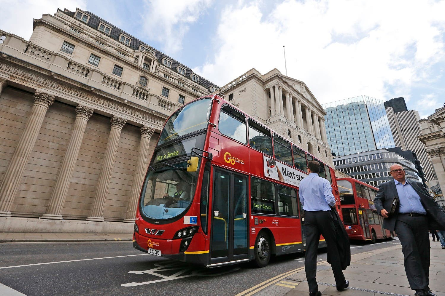 A London bus passes the Bank of England in London, Thursday, Aug. 4, 2016. The Bank of England is expected to cut interest rates close to zero and possibly inject billions in new money into the economy to help it endure the shock of the vote to leave the European Union AP