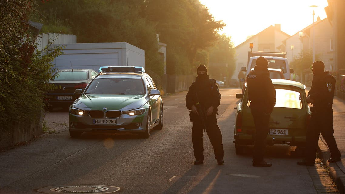 Police officers are seen outside an asylum seekers home in the southern German city of Ansbach on 25 July, 2016 A Syrian migrant set off an explosion at a bar in southern Germany that killed himself and wounded a dozen others late Sunday, authorities said, the third attack to hit Bavaria in a week. The 27-year-old, who had spent a stint in a psychiatric facility, had intended to target a music festival in the city of Ansbach but was turned away because he did not have a ticket. AFP