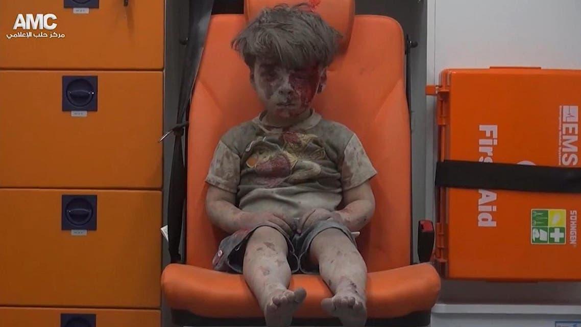 syrian boy ambulance aleppo AP AMC