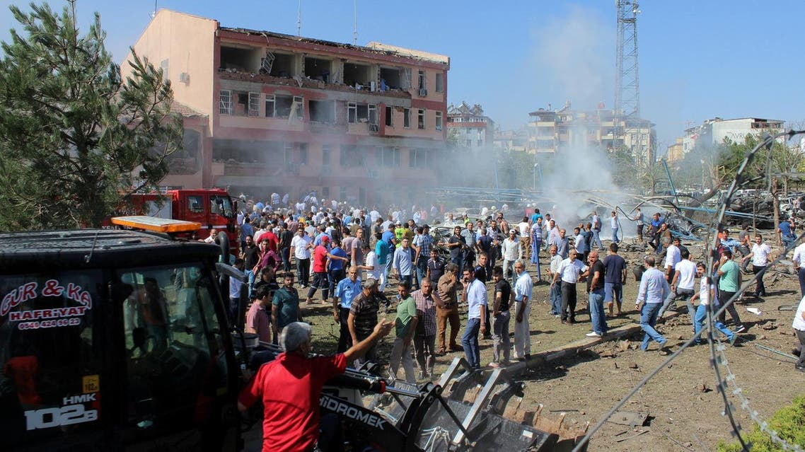 People rush to the blast scene after a car bomb attack on a police station in the eastern Turkish city of Elazig. (Reuters)
