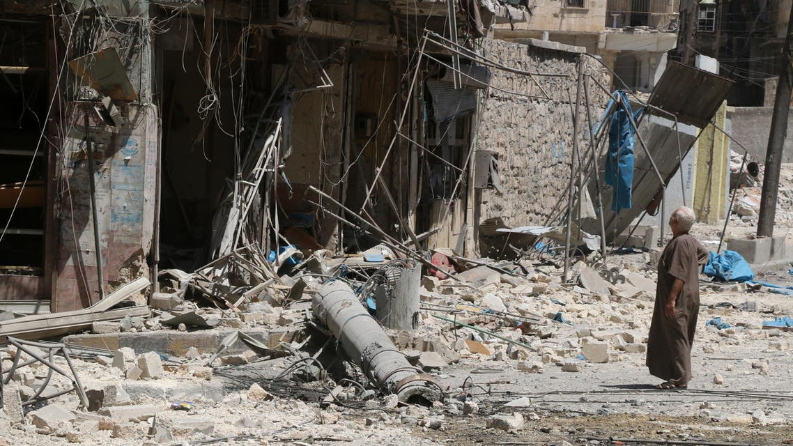 A resident of the Tariq al-Bab neighbourhood of Aleppo, inspects the damage caused by reported air raids that targetted rebel-held areas in the northern city on August 16, 2016. (AFP)