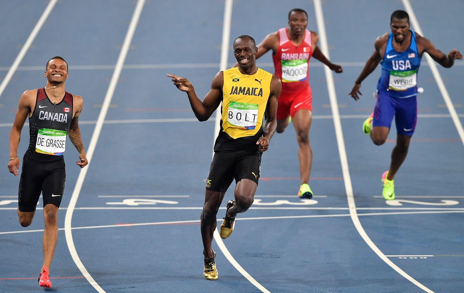 Jamaica's Usain Bolt, center left, and Canada's Andre De Grasse, left, compete in a men's 200-meter semifinal