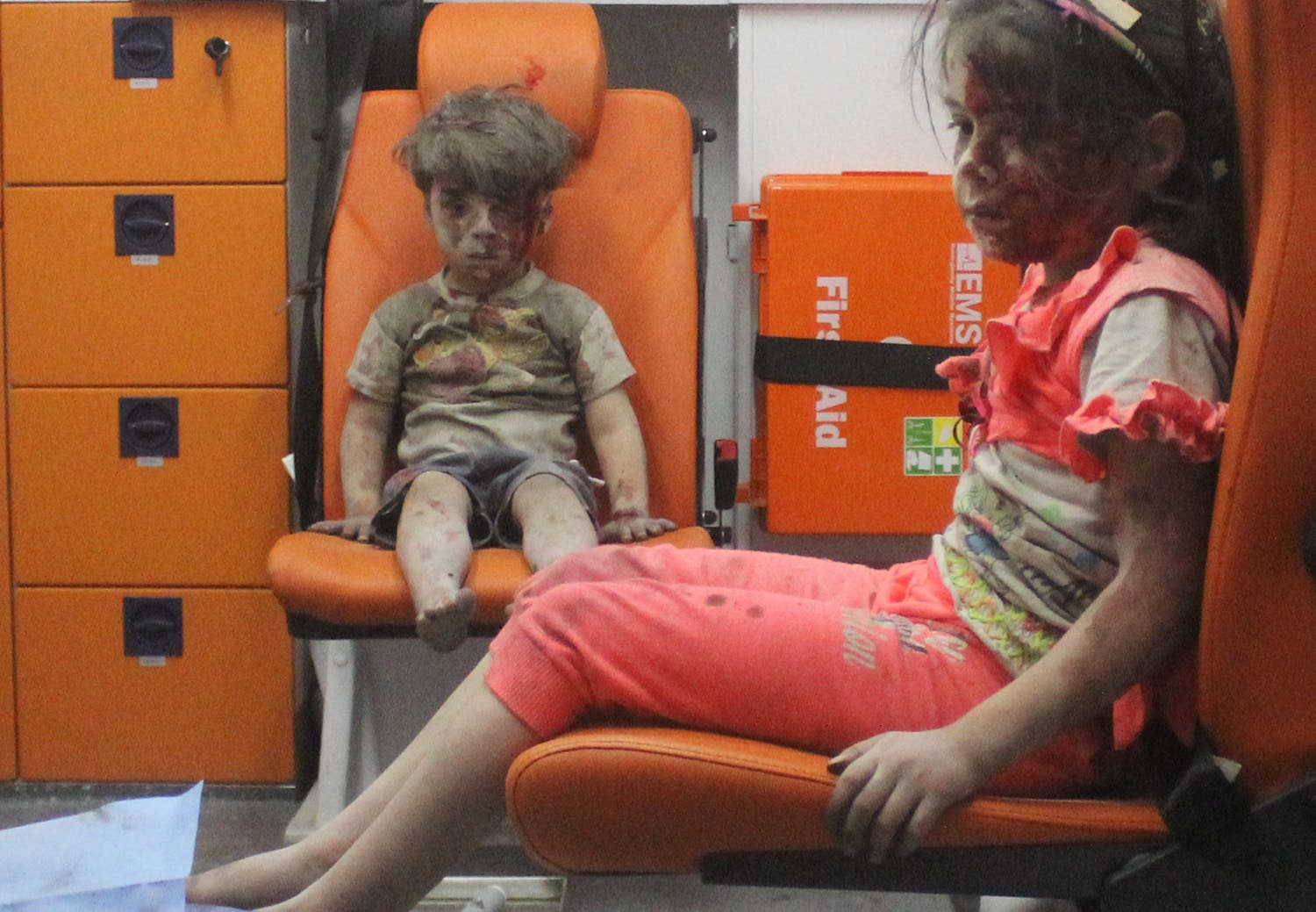 Five-year-old Omran Daqneesh, with bloodied face, sits with his sister inside an ambulance after they were rescued following an airstrike in the rebel-held al-Qaterji neighbourhood of Aleppo. (Reuters)