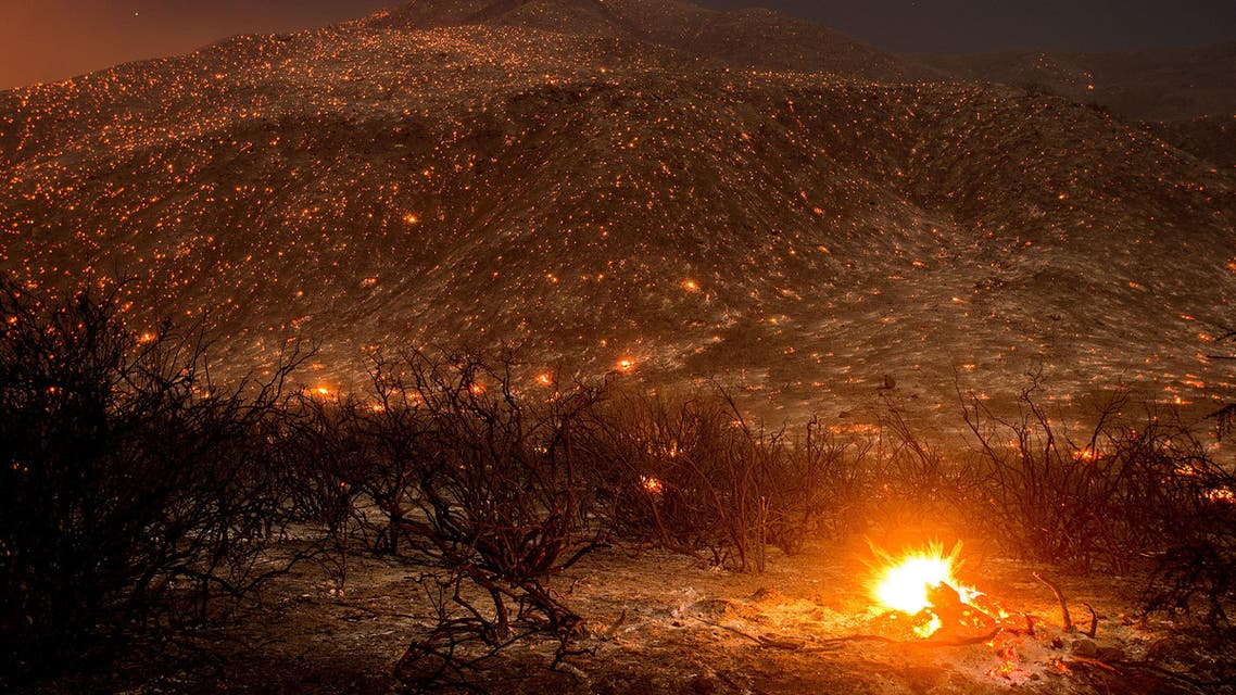 Embers from a wildfire smolder along Lytle Creek Road near Keenbrook, Calif., on Wednesday, Aug. 17, 2016. Firefighters had at least established a foothold of control of the blaze the day after it broke out for unknown reasons in the Cajon Pass near Interstate 15, the vital artery between Los Angeles and Las Vegas. (AP)