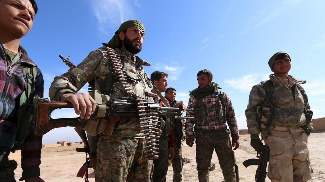Syria Democratic Forces fighters carry their weapons in a village on the outskirts of al-Shadadi town, Hasaka countryside, Syria February 19, 2016. (Reuters)