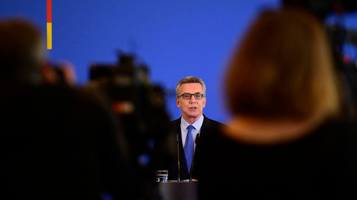 German Interior Minister De Maiziere said the full face veil 'does not belong in our cosmopolitan country'. (AFP)
