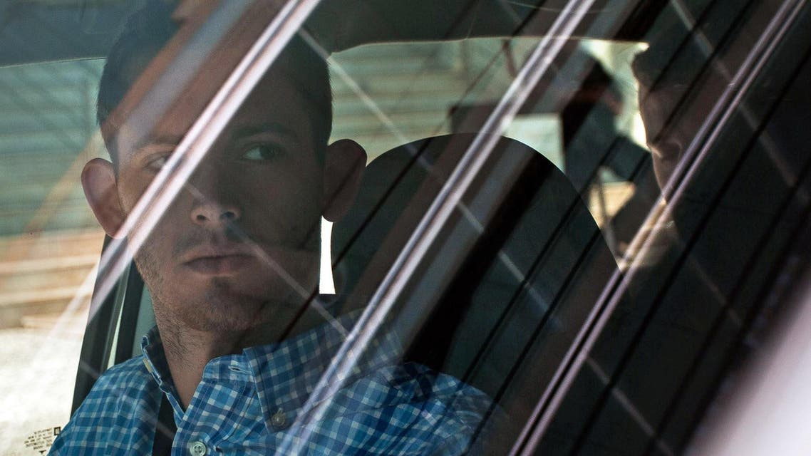 American Olympic swimmers Gunnar Bentz, left, and Jack Conger, in backseat, sit inside a car outside a police station where they were going to provide testimony in Rio de Janeiro, Thursday, Aug. 18, 2016. (AP)