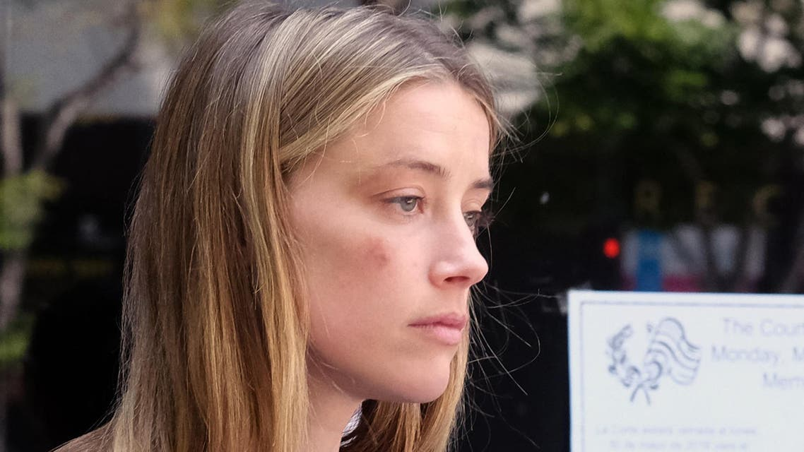 Actress Amber Heard leaves Los Angeles Superior Court on Friday, May 27, 2016, after giving a sworn declaration that her husband Johnny Depp threw her cellphone at her during a fight Saturday, striking her cheek and eye. (AP)