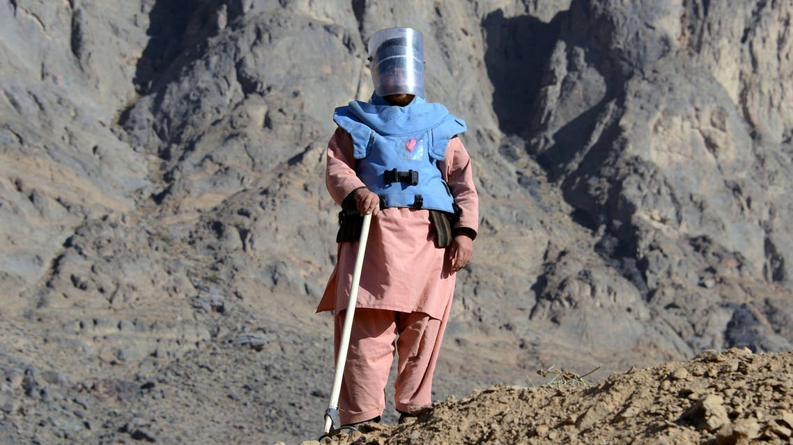 An Afghan de-mining security personnel looks on during an operation to clear mines from a field in the Panjwai district of Kandahar province on February 21, 2016. (AFP)