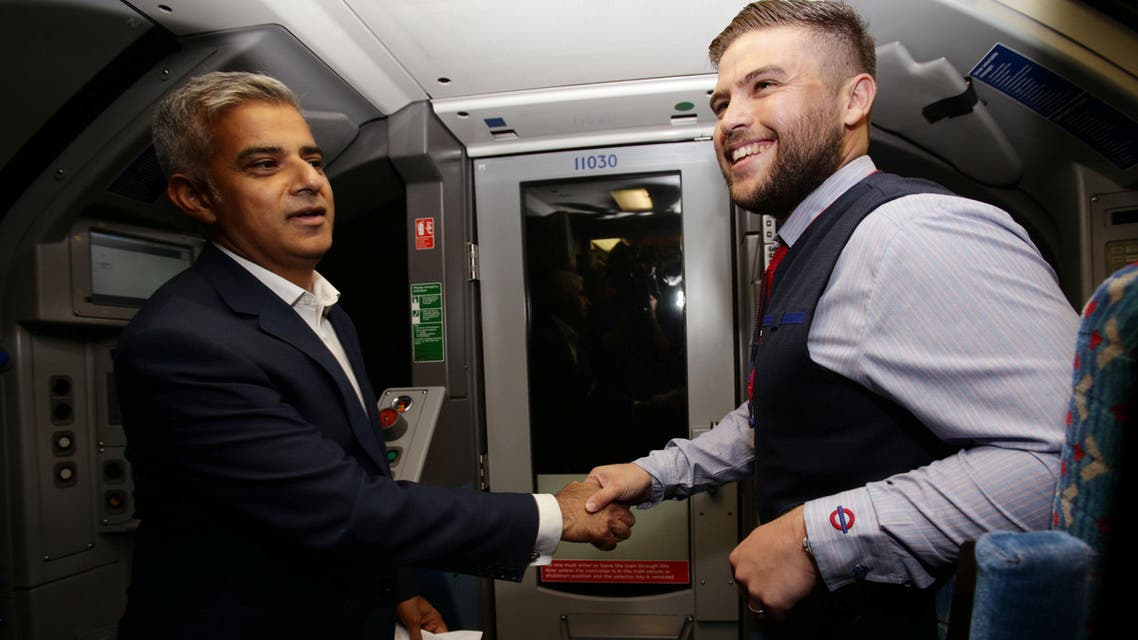 Mayor of London Sadiq Khan (left) with Daniel George, driver of the first Night Tube, in the drivers carriage of a Victoria line tube train at Brixton Underground station during the launch of London's Night Tube. (Reuters)