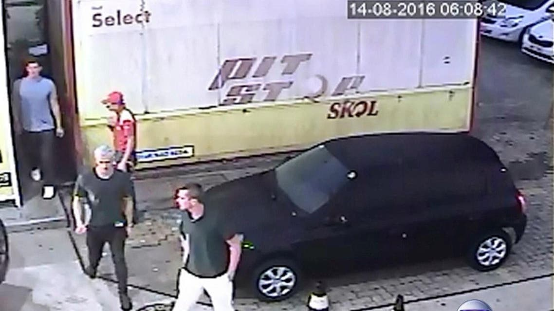 Security video shows three U.S. Olympic swimmers returning from a bathroom to their taxi at a gasoline station where they were accused by staff of having caused damage, in Rio de Janeiro, August 14, 2016.