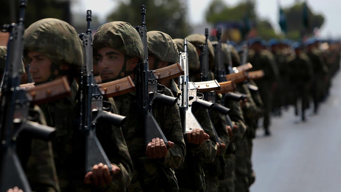 Turkish soldiers take part in the annual military parade, the highlight of celebrations marking the 42nd anniversary of the 1974 Turkish invasion, in the Turkish-controlled northern part of Nicosia in this ethnically divided island of Cyprus, on Wednesday, July 20, 2016. This year's parade was a muted affair with neither warplanes nor heavy battle tanks making an appearance following a decision by Turkish Cypriot leaders and army commanders to keep celebrations low key in the wake of the failed coup in Turkey. (AP)