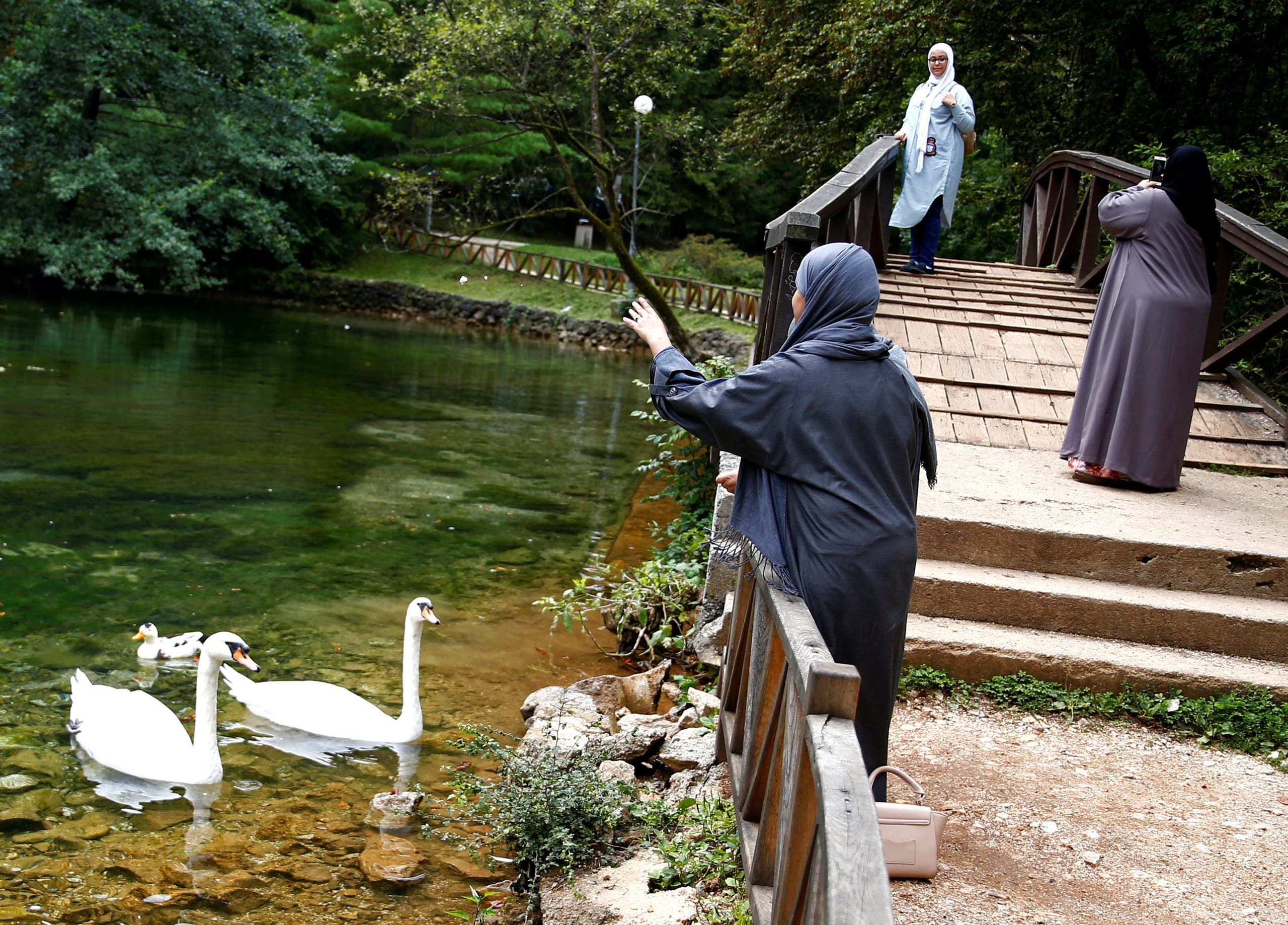 Tourists from the Middle East enjoy at Vrelo Bosne nature park in Ilidza near Sarajevo, Bosnia and Herzegovina, August 19, 2016. reuters
