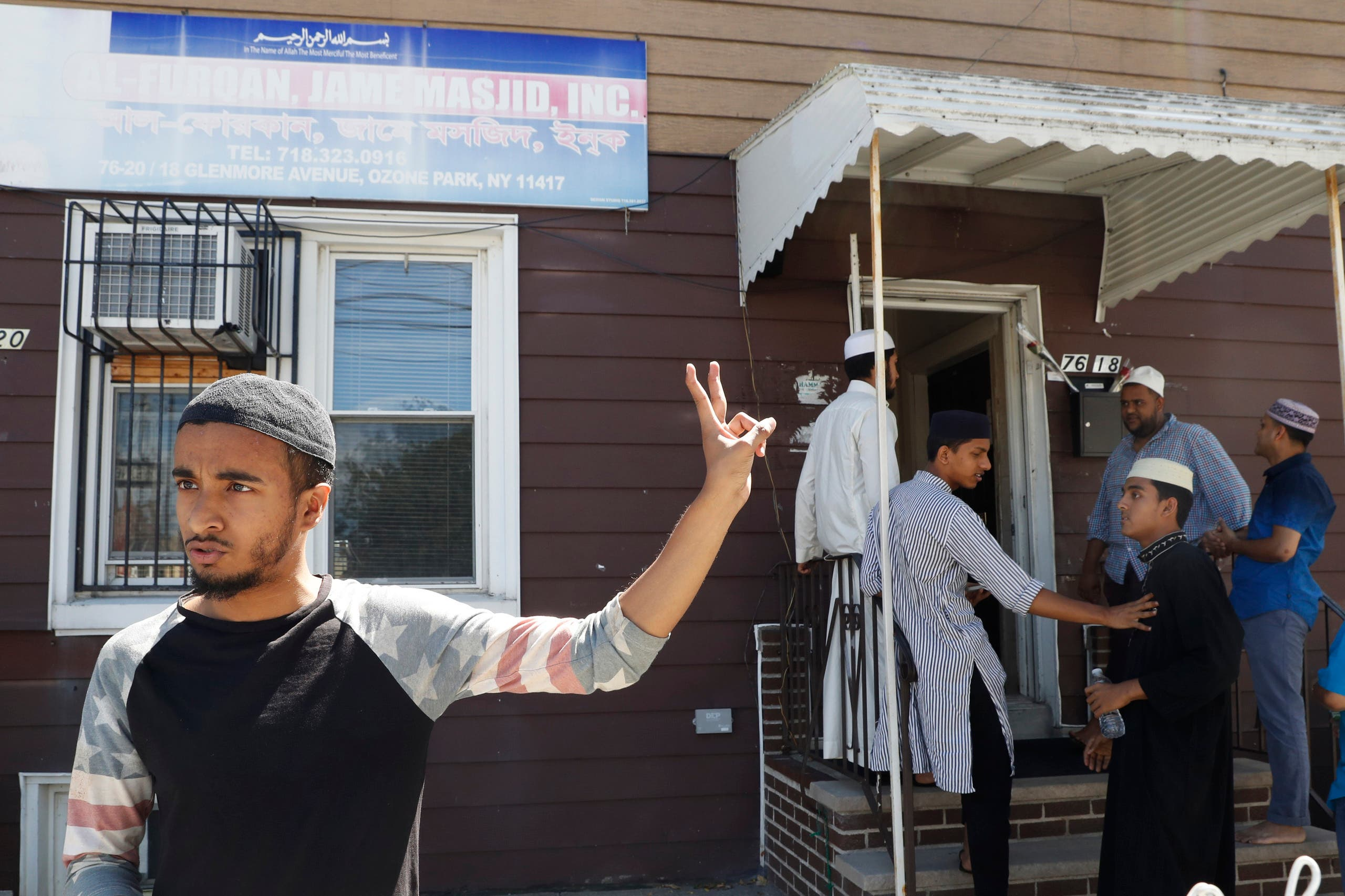In this Wednesday, Aug. 17, 2016, photo Ashik Uddin gestures as he speaks during an interview with The Associated Press outside the Al-Furqan Jame mosque in the Ozone Park neighborhood of the Queens borough of New York. The shooting of an imam and his assistant near their New York mosque has unnerved Muslim residents of the Ozone Park section of Queens. (AP)