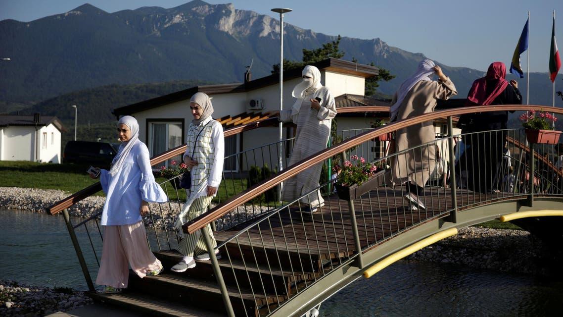 Tourists from the Middle East walk through Sarajevo Resort in Osenik near Sarajevo, Bosnia and Herzegovina, August 10, 2016. reuters