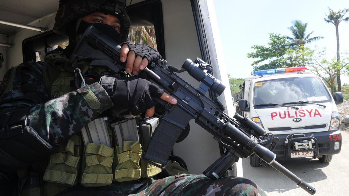 POLICE  Ansar Al Khilafah (AFP)