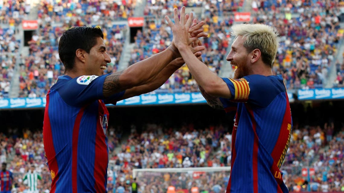 Barcelona's Luis Suarez and Lionel Messi celebrate a goal against Real Betis. REUTERS